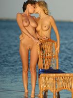 Two Naked Girls Kissing at the Beach