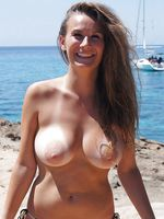 Beautiful Lady with Big Boobs Topless on the Beach