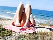 Horny girl is masturbating at the beach and films on camera